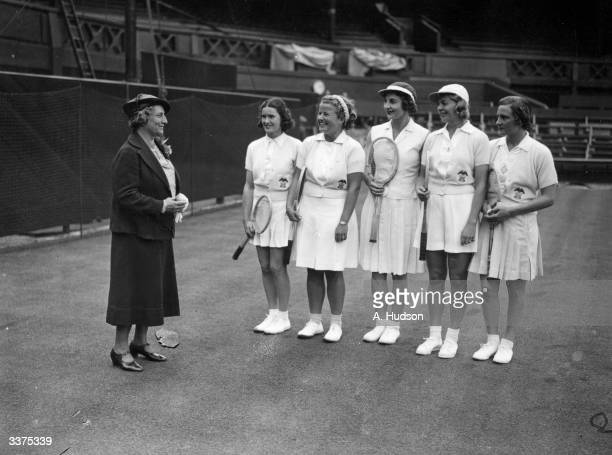 Hazel Wightman former American tennis champion founder of the Wightman Cup and captain of the US Wightman Cup team chatting to the team on the centre...