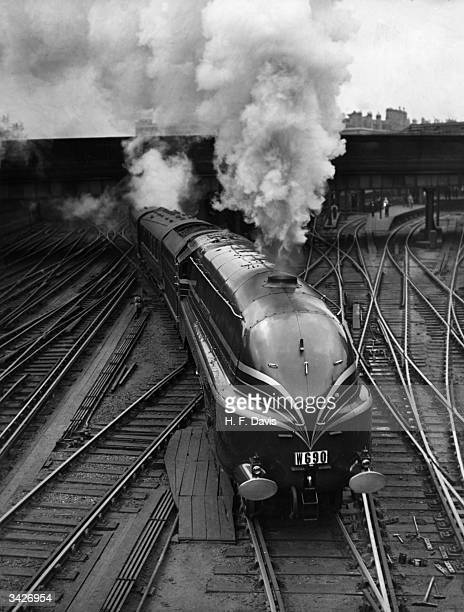 The new LMS streamlined locomotive 'Duchess of Gloucester' leaves Euston Station in London on her first long distance journey She is transporting...