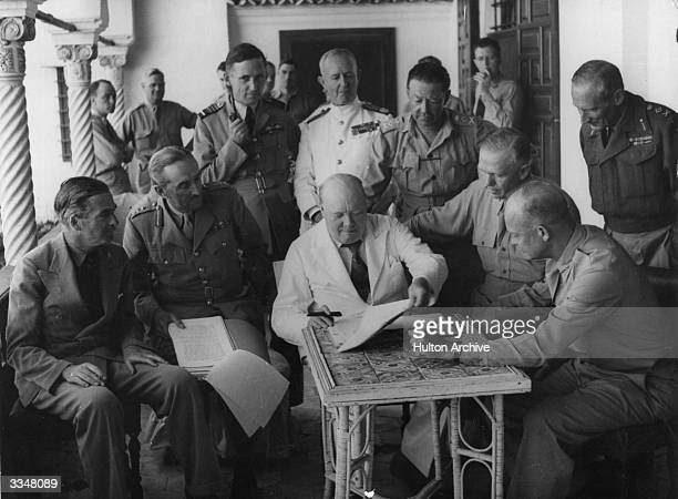 A conference at Allied Forces headquarters in North Africa British Foreign Secretary Anthony Eden Lord Alanbrooke Air Chief Marshal Tedder Admiral...