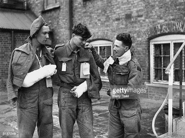 To R, Private R Chase of London, Private Geoffrey Smith of Beverly, Yorks and Trooper George Hart of Kent arrive at the Ministry of Health Emergency...