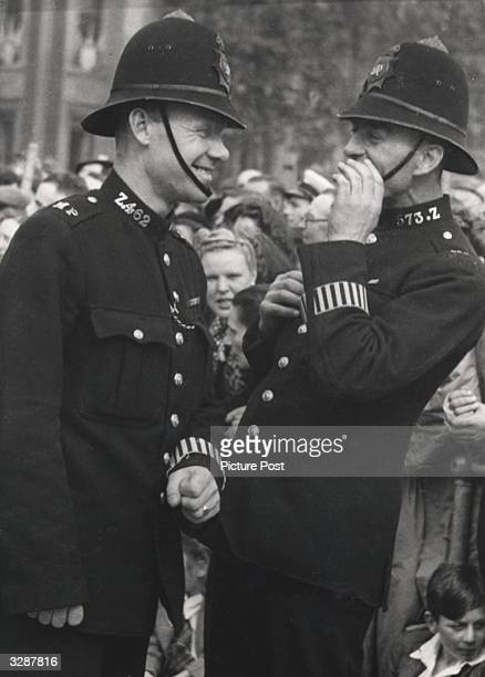 Two policemen share a joke during the V Day celebrations Original Publication Picture Post 4093 Why We Celebrated pub 1946