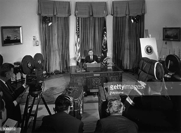 US president John F Kennedy makes a broadcast to the American public from his White House office in Washington DC upon his return from a trip to...
