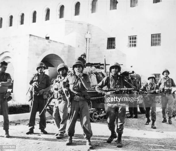 Israeli soldiers stand outside the UN Headquarters in Jerusalem after liberating it from the Jordanians during the Six Day War