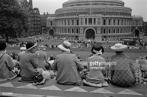 Members of the Women's Institute from all over the country take their lunch break opposite the Albert Hall during the 50th Annual General Meeting of...
