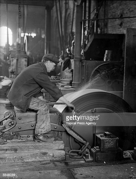 A worker sharpening tools at London and North Western Railway works Crewe Cheshire