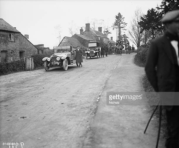 Chauffeurs wait by the Rolls Royce and Daimler cars belonging to members of the Grafton Hunt Northamptonshire