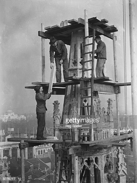 Workmen on scaffolding at the top of the spire of St John's church in Cardiff where they are carrying out repairs