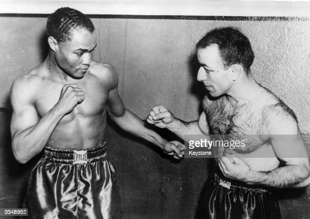 American featherweight boxer Henry Armstrong in training with Pete Sarron