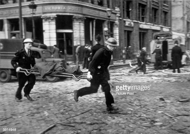 Air raid wardens running to the rescue in Farringdon London after a V2 bomb exploded Original Publication Picture Post 1967 Bomb Damage pub 1945