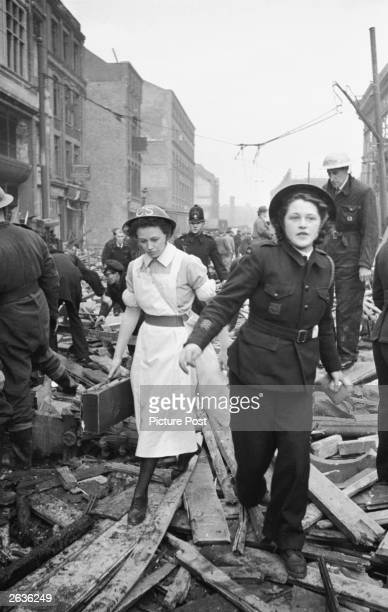 Rescue workers at the scene of a V2 rocket attack on Farringdon Market in London during World War II They are ambulance driver Jean Grover and a...