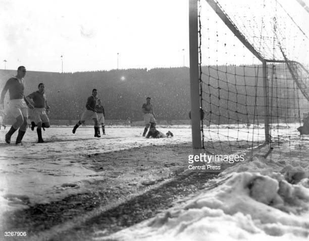 Blackpool score their first goal against Chelsea on a snowcovered pitch at Stamford Bridge London From left to right are Steffan of Chelsea Stan...