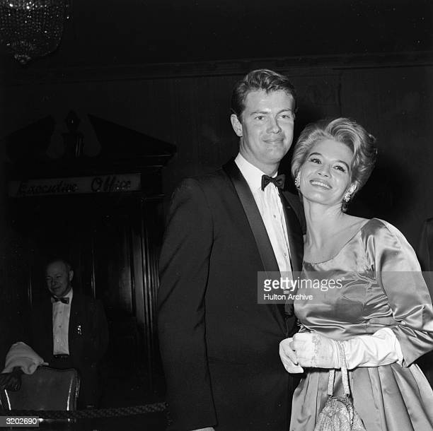 American actors Troy Donahue and Angie Dickinson smile at the Golden Globe Awards Hollywood California Donahue won Most Promising Newcomer Male...