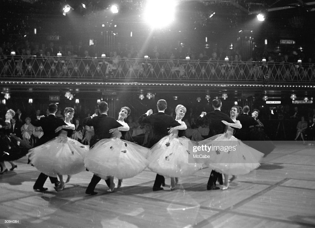 A display of ballroom dancing at the Empire Ballroom, attended by a number of celebrity guests.
