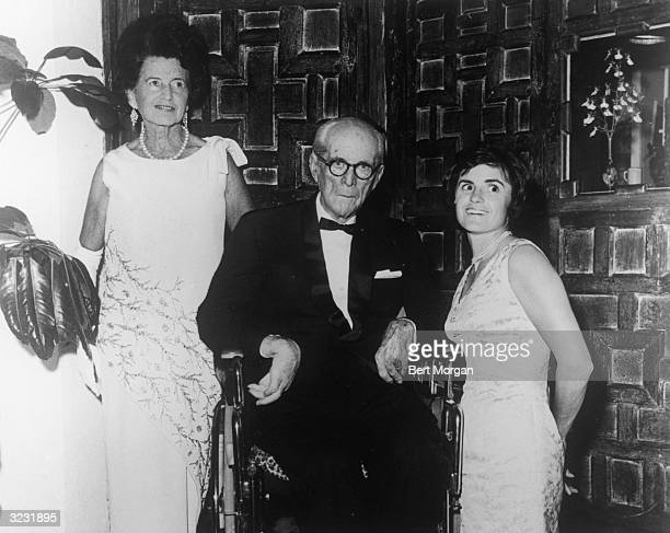 Rose Kennedy and her husband, American financier Joseph P Kennedy , pose with their niece, Anne Gargan, at the St. Mary's Hospital Ball about eight...