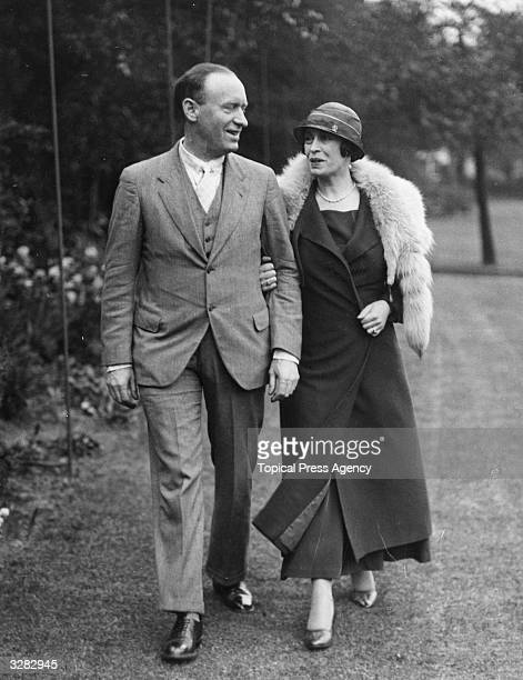 Mr Aime Felix Tachiffeley author and his fiancee Miss Violet Marquesita actress walk arm in arm in a London square