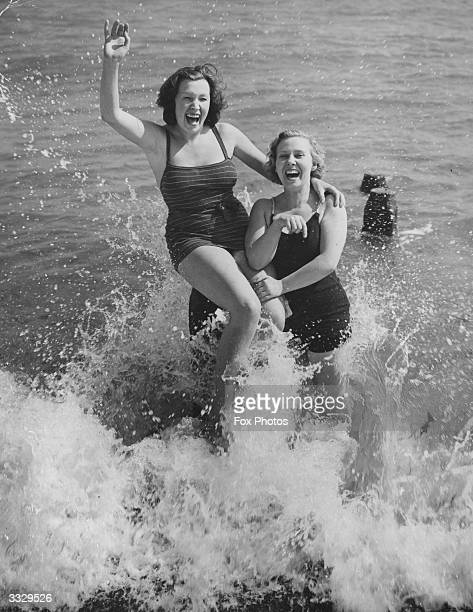 Two holidaymakers at Southsea enjoying their first dip of the season