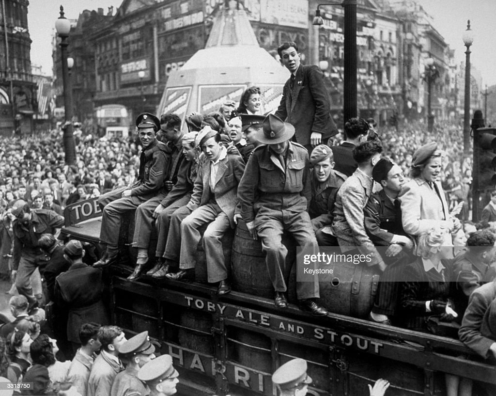 A van load of beer passing through Piccadilly Circus on VE Day. The statue of Eros, protected during the war by advertising hoardings, can be seen in the background.
