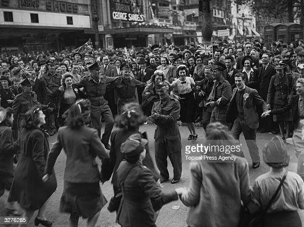 Canadian troops entertain the crowds in Leicester Square while waiting for the broadcast of the King's VE Day speech