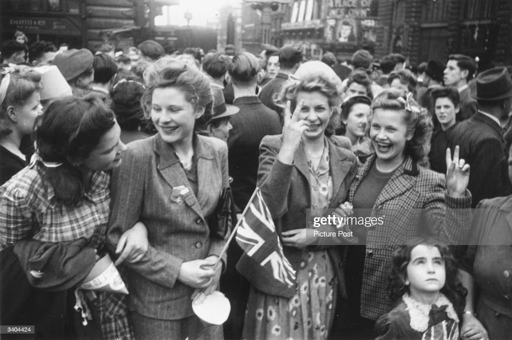 Crowds celebrating VE day on the streets of London. Original Publication: Picture Post - 1991 - This Was VE Day In London - pub. 1945