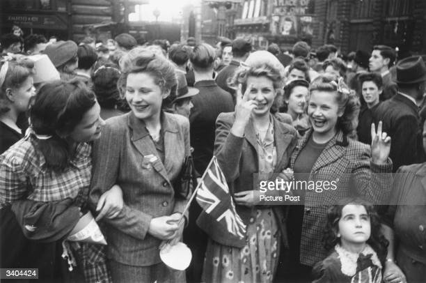 Crowds celebrating VE day on the streets of London Original Publication Picture Post 1991 This Was VE Day In London pub 1945
