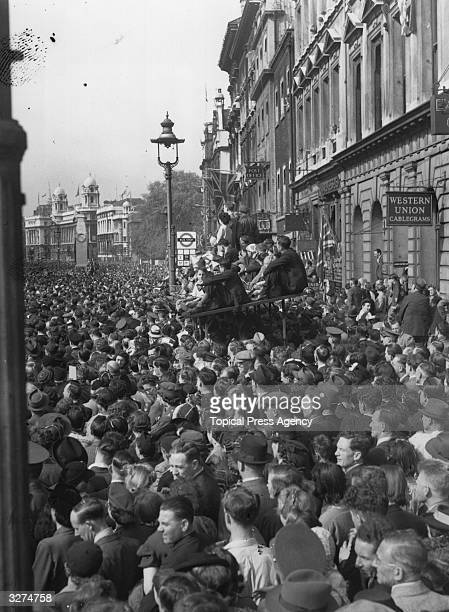 Crowds in Whitehall listening to the Prime Minister's speech on VE Day