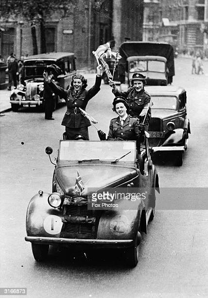 Jubilant ATS girls commandeer an army car for their VE Day celebrations.