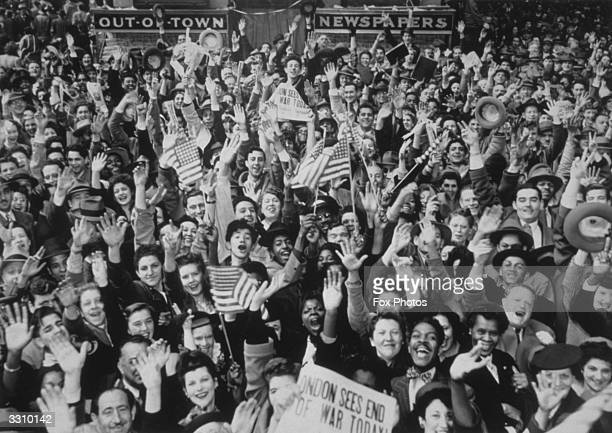 New Yorkers shout their joy at hearing reports of Germany's unconditional surrender