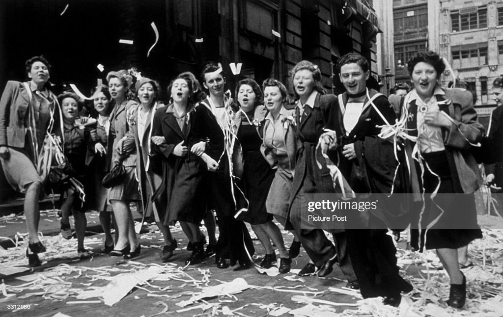 People dancing in the streets of London during the celebrations for VE Day. Original Publication: Picture Post - 1991 - This Was VE Day In London - pub. 19th May 1945