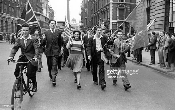 Students from London University stage an impromptu VE Day parade Original Publication Picture Post 1991 This Was VE Day In London pub 1945