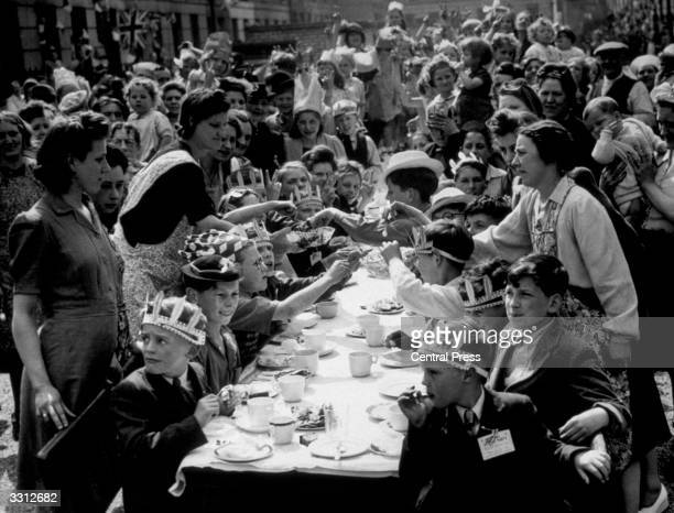 The residents of Tilloch Street Islington London who organised a tea party in the street for their children at Whitsun