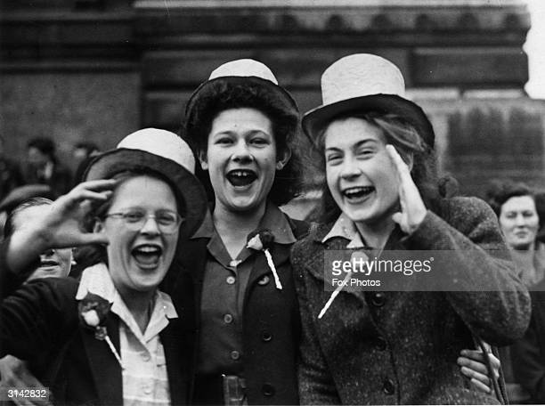 Three girls join in the VE Day celebrations in Downing Street London