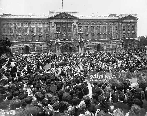 VE day held to commemorate the official end of Britain's involvement in World War II is celebrated by a crowd outside the gates of Buckingham Palace...