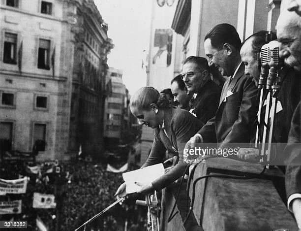 Eva Peron former actress and wife of Argentinian president Juan Peron with government officials on a balcony at the Plaza de Mayo Buenos Aires where...
