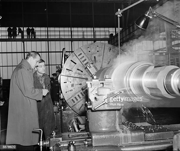 Prince Philip, Duke of Edinburgh in conversation with craven lathe operator Joe Howsley in the Central Repair shop at the Steel Company of Wales at...