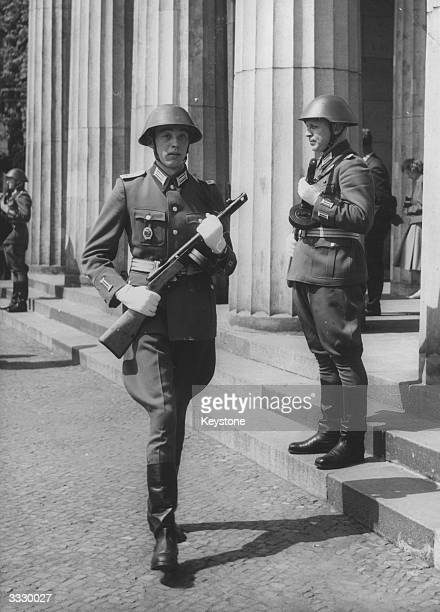 Two soldiers in the East German Army the 'Volksarmee' on guard duty outside the Neue Wache museum on Unter den Linden in East Berlin
