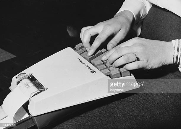 A woman demonstrating a new portable shorthand machine in Hanover