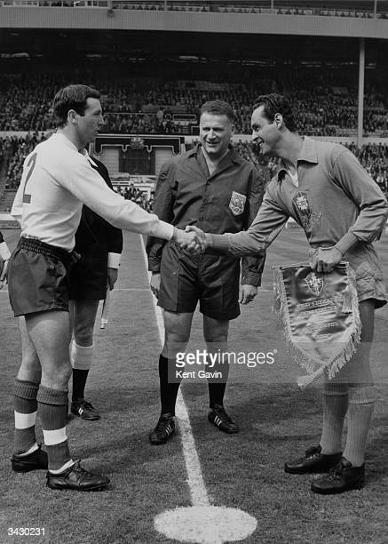 Jimmy Armfield the England captain shaking hands with his Brazilian counterpart Dos Santos Gilmar while the Dutch referee L Horn looks on