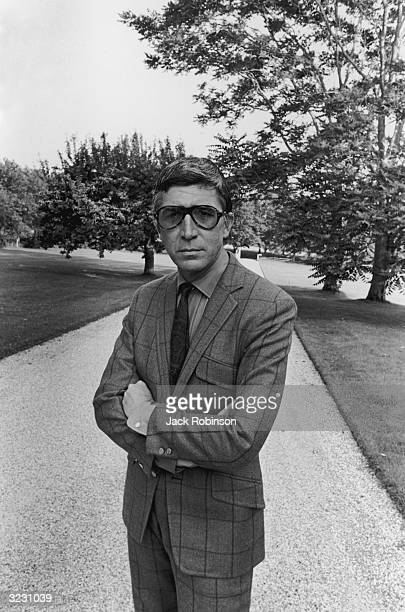 American actor Patrick O'Neal wearing a windowpanecheck wool gabardine suit and sunglasses as he poses on a gravel driveway in a photo shoot for...