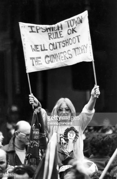 An Ipswich Town supporter cheering on her team during the FA Cup Final match against Arsenal