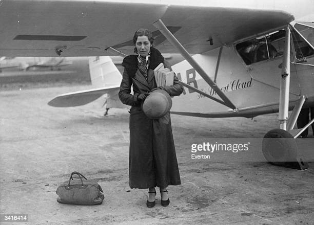 Amy Johnson by her plane at Stag Lane Aerodrome London A pioneer aviator she flew solo from England to Australia to Japan via Siberia and to Cape...