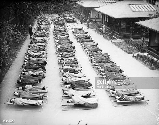 Children suffering from TB sleep outside at Springfield House Open Air School, Clapham Common, London.