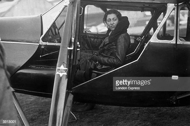 Pilot Amy Johnson seen in the cockpit of her 'Puss Moth' aeroplane just before taking off on a flight to South Africa