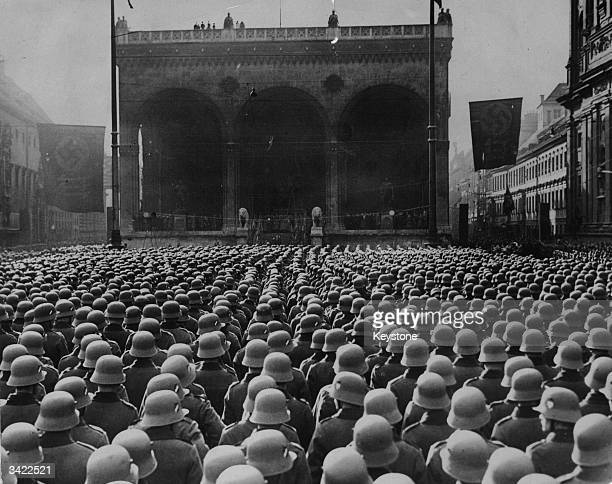 A sea of steel helmets in front of the Feldherrnhalle in Munich where thousands of new recruits are gathered to swear an oath of fealty to Germany's...