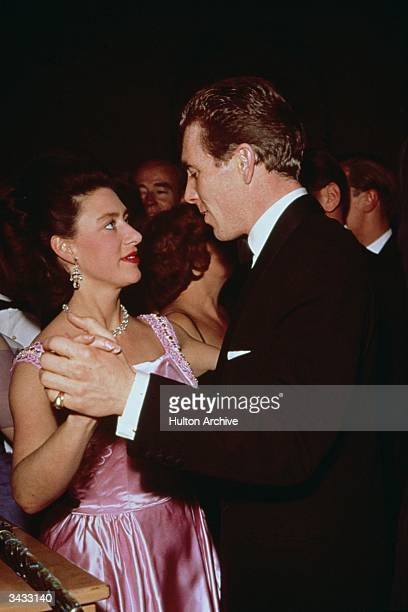 Princess Margaret dancing with her husband Lord Snowdon at a Dockland Ball in the Savoy Hotel