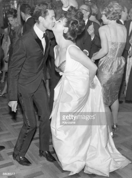 Diane Westbury, Miss United Kingdom, dances with choreographer Lionel Blair at a dance for the Miss World competitors at the Cafe de Paris, London.