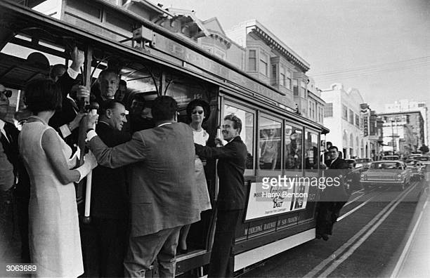 Princess Margaret and Lord Snowdon travel on the famous cable car system during a visit to San Francisco