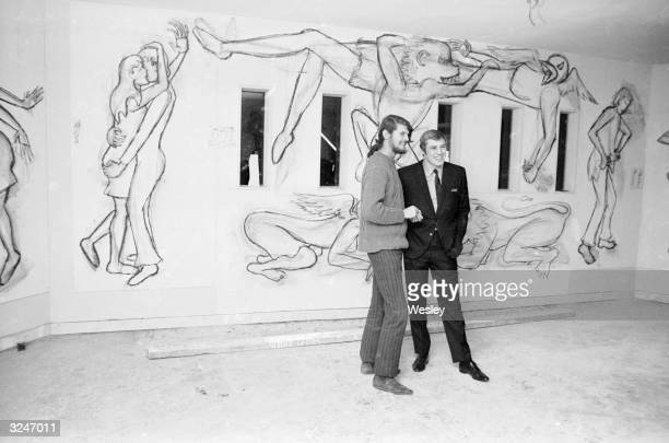Viscount Weymouth later Marquess of Bath discusses his murals with boxer Billy Walker director of the Upper Cut a massive new leisure centre in...