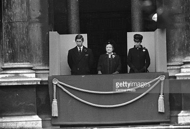 Charles Prince of Wales the Queen Mother and Princess Anne look down in a sombre mood at the fiftieth anniversary of the unveiling of the cenotaph in...