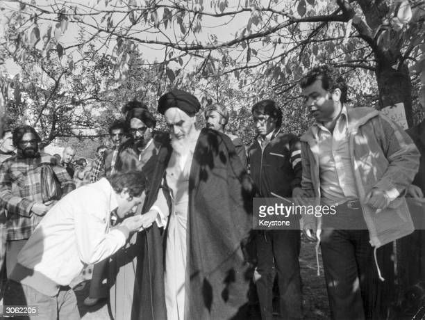 Iranian leader Ayatollah Khomeini in the garden of his French home at Neauphle le Chateau