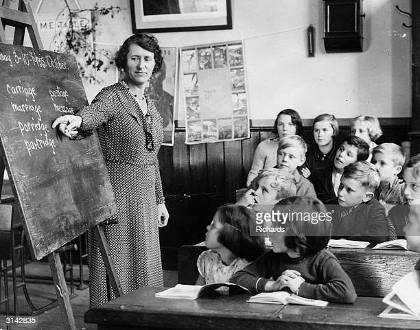 A teacher conducts a reading class at Peterstone Council School Wentloog Monmouthshire With only twelve pupils it is the smallest school in Wales